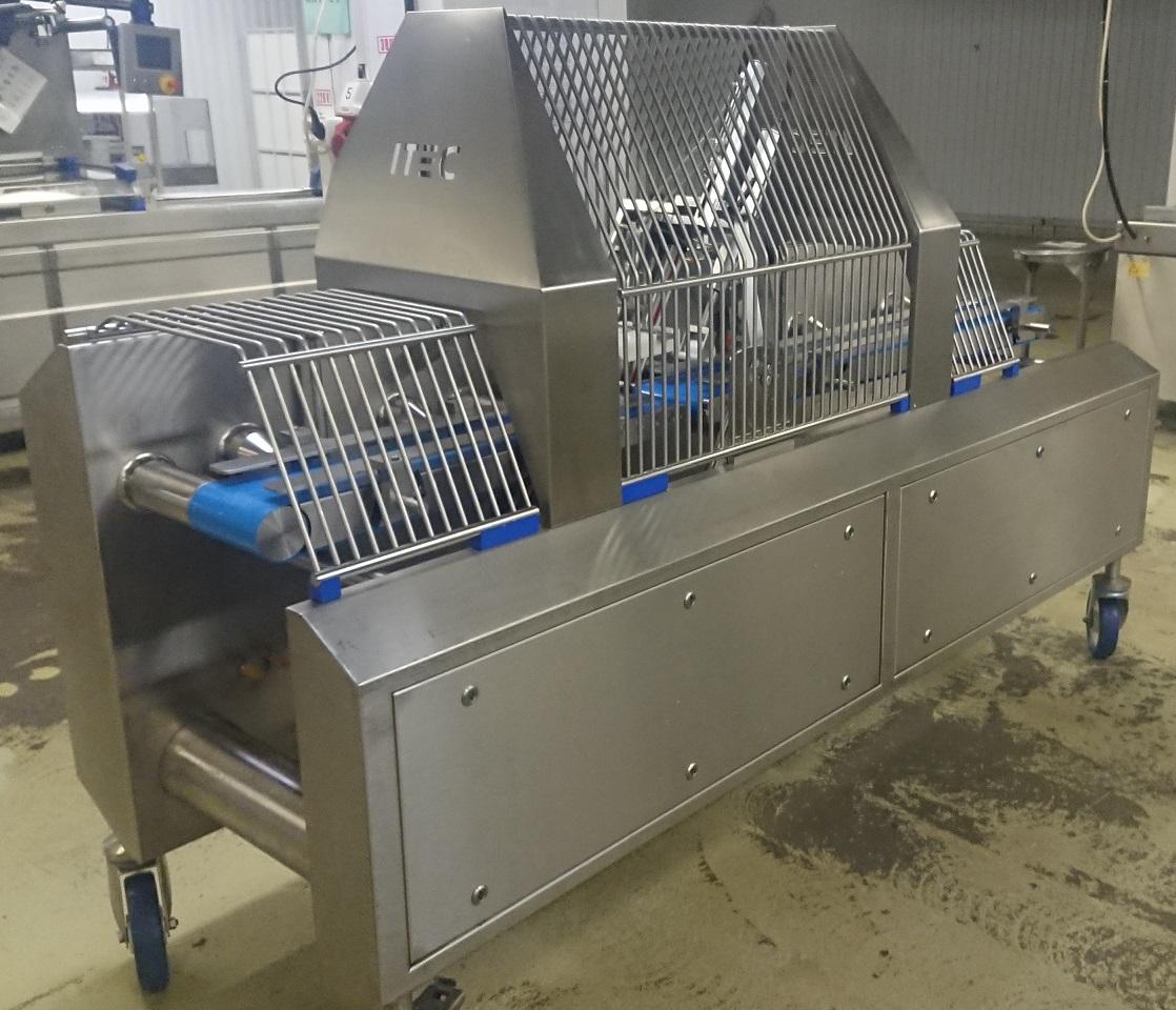Машина для резки колбасного батона под углом